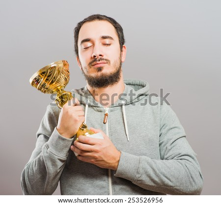 business man raising his trophy