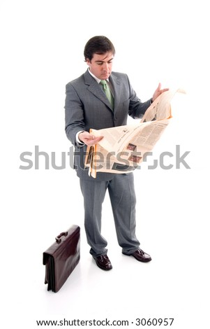 Business man reading business section of newspaper on white background - stock photo