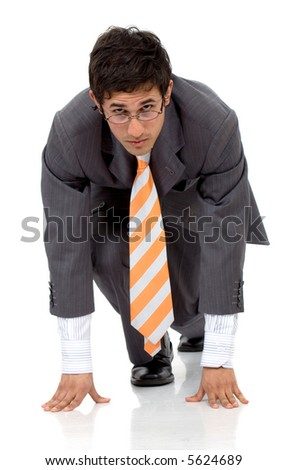 Business man ready to race against the competition isolated over a white background - stock photo