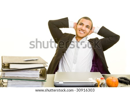 Business man relaxing at his desk - stock photo
