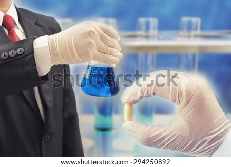 business man research chemistry at science lab , pharmaceutical concept background - stock photo