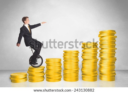 Business man riding monocycle up on coin graph concept on background - stock photo