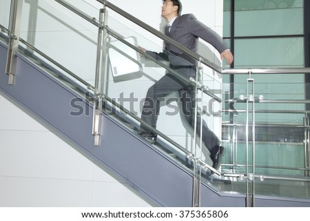Business Man Running Up Stairs - stock photo