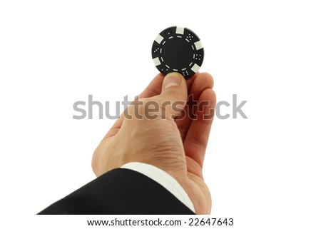 Business man's hand holding a casino chip isolated on white - stock photo