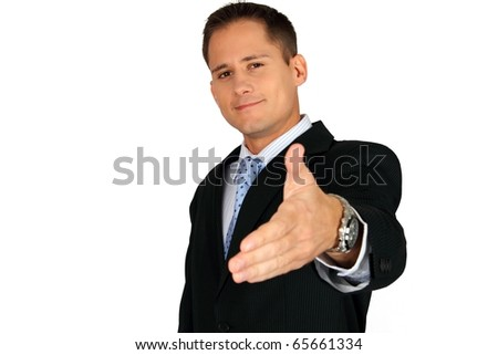 Business man saying welcome and giving hand - stock photo