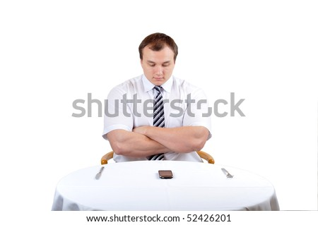Business man seat before a table and waiting on phone, isolate white background. - stock photo