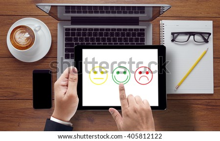 business man select happy on satisfaction evaluation? ontable top view,coffee - stock photo