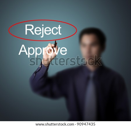 business man select reject by make red mark on whiteboard - stock photo