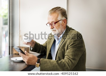 Business Man Senior Using Device Concept - stock photo