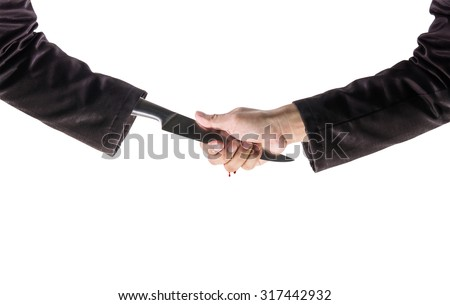 Business Man Shake hands with a business man Knife hand ,Business recreant or business betray  concept, with Clipping Path