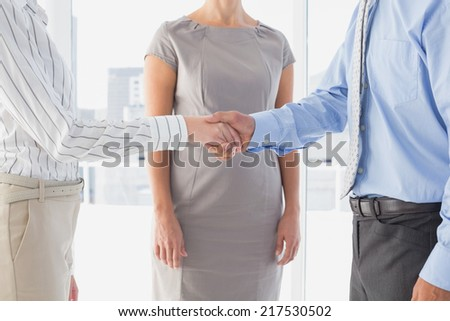 Business man shaking colleagues hand at work - stock photo