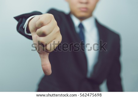Business man  show thumbs down