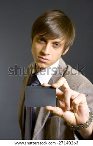 Business man showing a blank business card