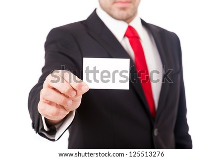 Business man showing a blank business card over white background - stock photo