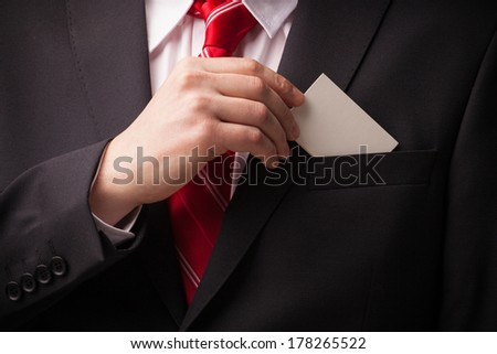 Business man showing a blank empty business card - stock photo
