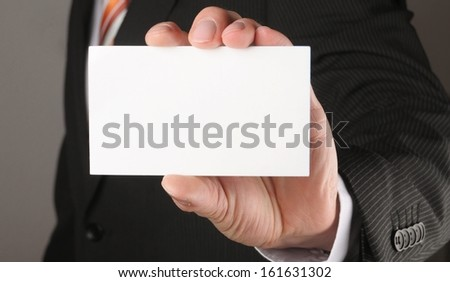 business man showing blank business card or sign - stock photo