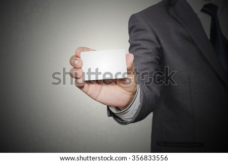 business man showing business card , business idea concept