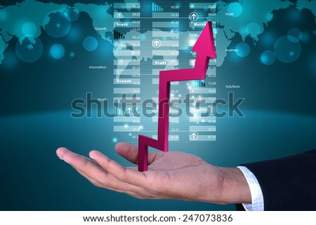 Business man showing growth graph - stock photo