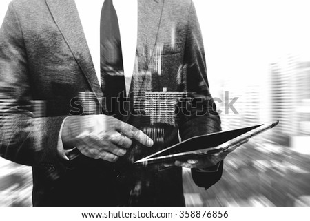 business man showing hand and finger composite with blur building - stock photo