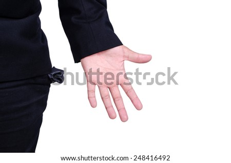 business man showing his empty pockets demonstrating he has no money isolated on white background - stock photo