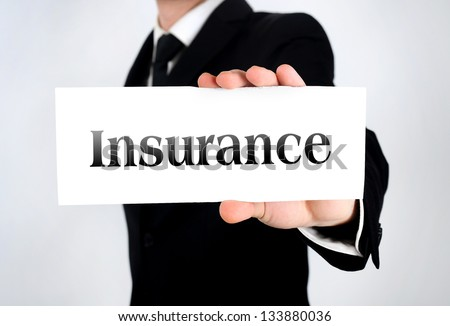 Business man showing insurance word - stock photo