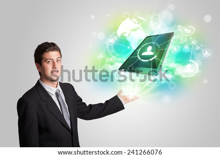 Business man showing modern green tablet technology concept - stock photo