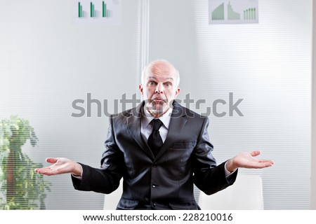 business man showing off empty hands meaning he can't do nothing - stock photo