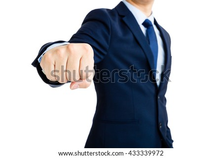 Business man showing punch gesture
