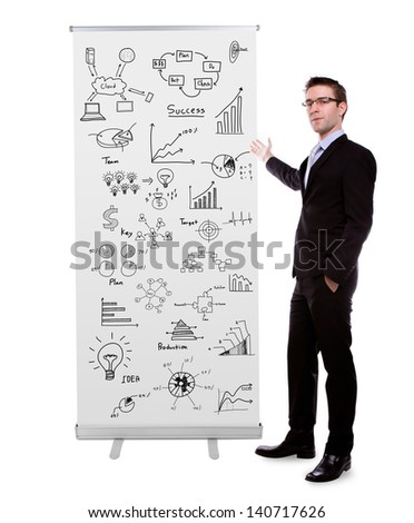 Business man showing  roll up banner display with graph isolated on white background - stock photo