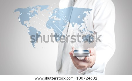 Business man showing smart phone with world map for social and internet connectivity concept - stock photo