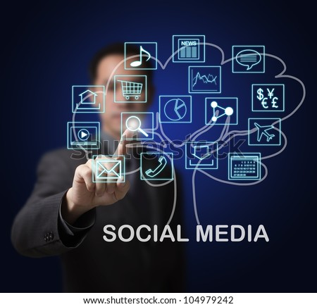 business man showing that social media are the root of many online internet application marget growth - stock photo