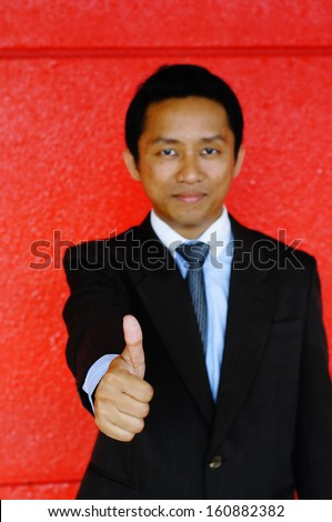 business man showing thumbs up - stock photo