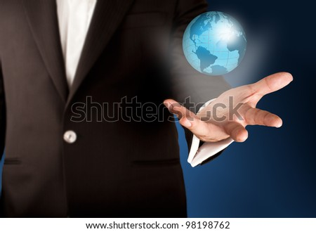 Business man showing wire frame glowing globe on hand