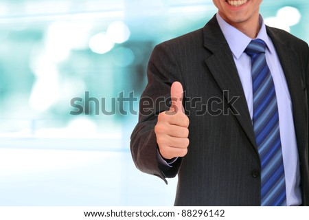 Business man shows thumb up - stock photo
