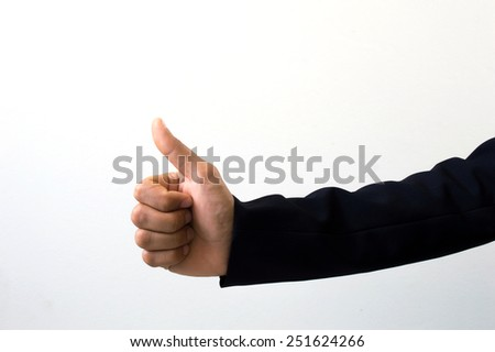 business man side view of thumbs up sign - stock photo