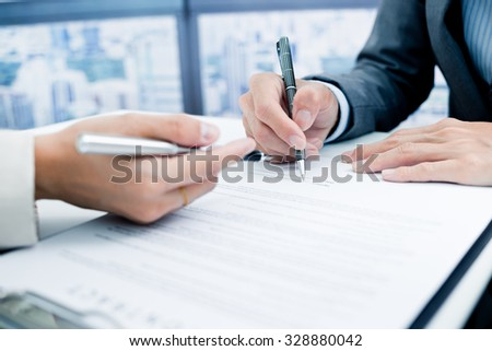 Business man signing a contract
