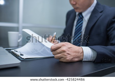 Business man signing a contract  . Close-up photo