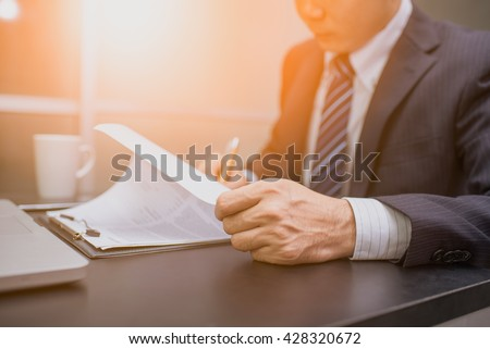 Business man signing a contract  . Close-up photo - stock photo