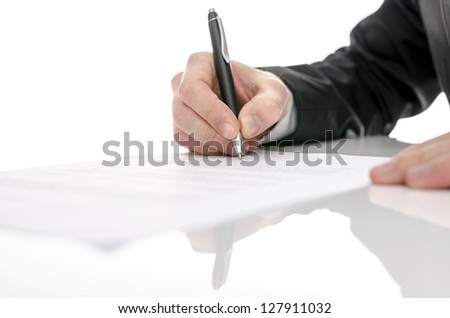 Business man signing a contract on a white table. With selective focus.