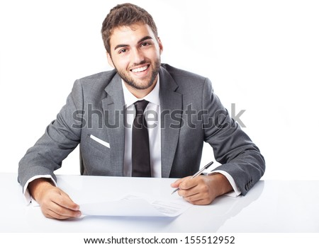 business man singing a contract on his desk on white background - stock photo