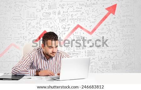 Business man sitting at table with market hand drawn diagrams