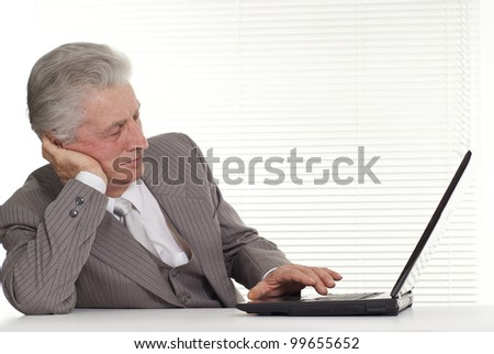 Business man sitting at the computer on a isolate
