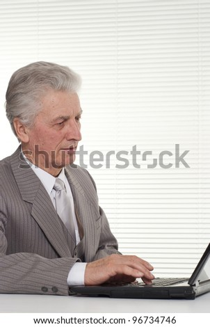Business man sitting at the computer on a light background
