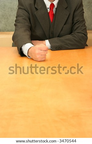 Business-man sitting at the desk, angry. - stock photo