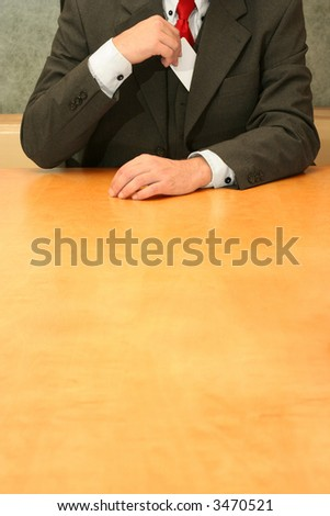 Business-man sitting at the desk, introducing himself. - stock photo