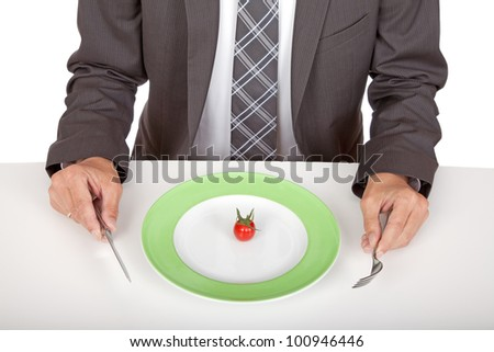 business man sitting in front of his mini snack - stock photo