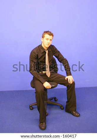 Business Man sitting on a chair - stock photo