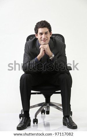 Business man sitting on office chair - stock photo
