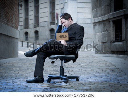 Business Man sitting on Office Chair on Street in stress asking for help - stock photo