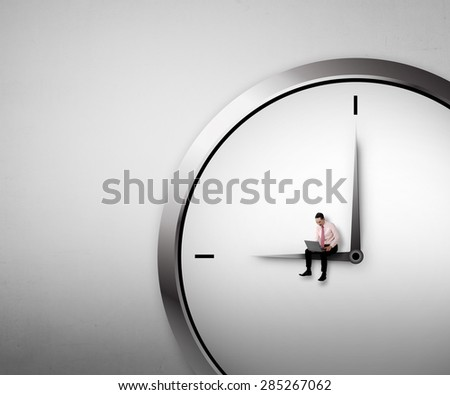 Business man sitting on the clock. Overtime conceptual - stock photo